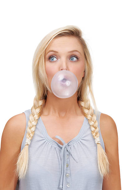 practising her bubble blowing - pigtails stock photos and pictures