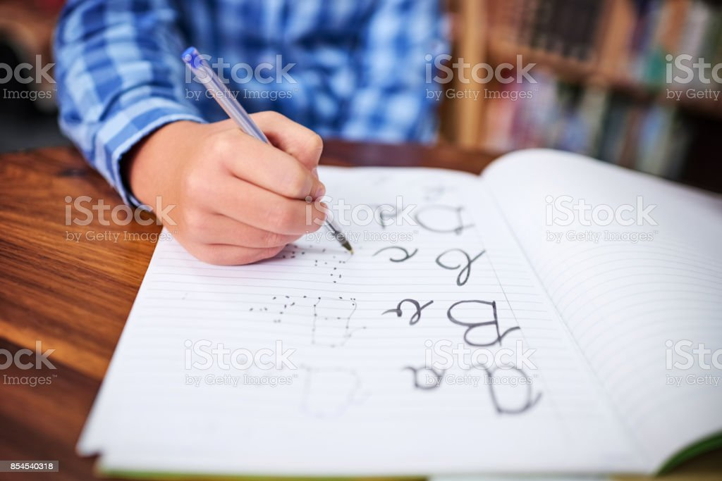 Practising his handwriting stock photo