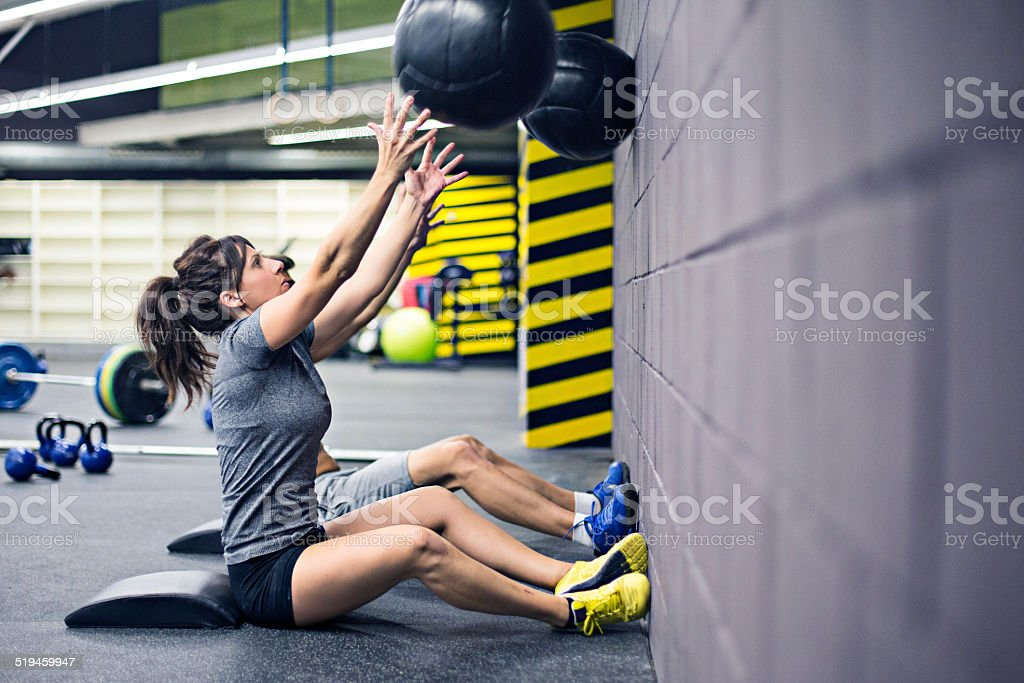Practising with the medicine balls on the wall stock photo