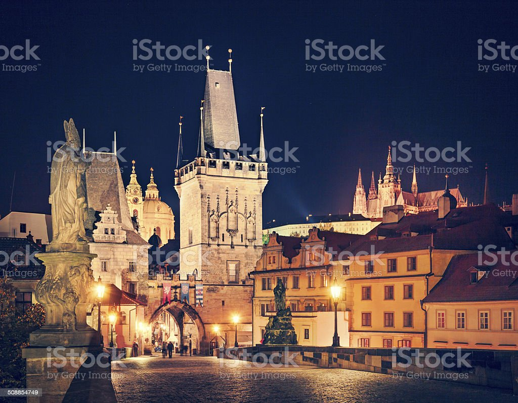 Prague at night with Charles Bridge, Hradcany and cathedral. stock photo