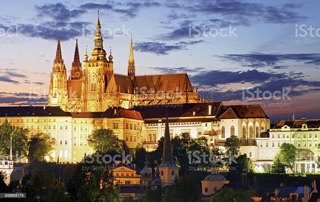 Prague castle and Charles bridge at night stock photo