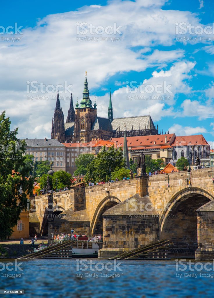 Prague castle and Wooden icebreaker that protects the pillars of Charles Bridge from the winter ice on the Vltava river in Prague stock photo