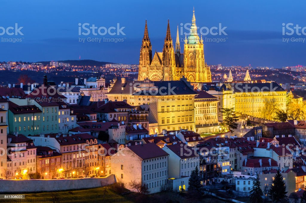 Prague Castle complex with gothic St Vitus Cathedral, Hradcany, Prague, Czech Republic. UNESCO World Heritage. Panoramic aerial shot from Petrin Hill. stock photo