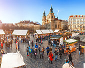07 December 2017, Prague, Czech Republic: Prague Christmas market on Old Town Square with crowds of tourists and beautiful architecture at the background