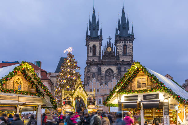 Prague Christmas market on the night in Old Town Square with blurred people on the move. Prague, Czech Republic. Prague Christmas market on the night in Old Town Square with blurred people on the move. Prague, Czech Republic. tyn church stock pictures, royalty-free photos & images
