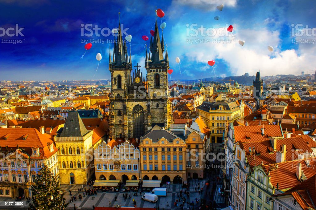 Prague city landscapes on a beautiful cloudy day and heart style balloons on the sky stock photo
