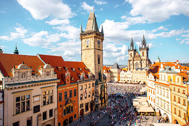 Prague cityscape view Cityscape view on the clock tower and Tyn cathedral on the old square in Prague. tyn church stock pictures, royalty-free photos & images