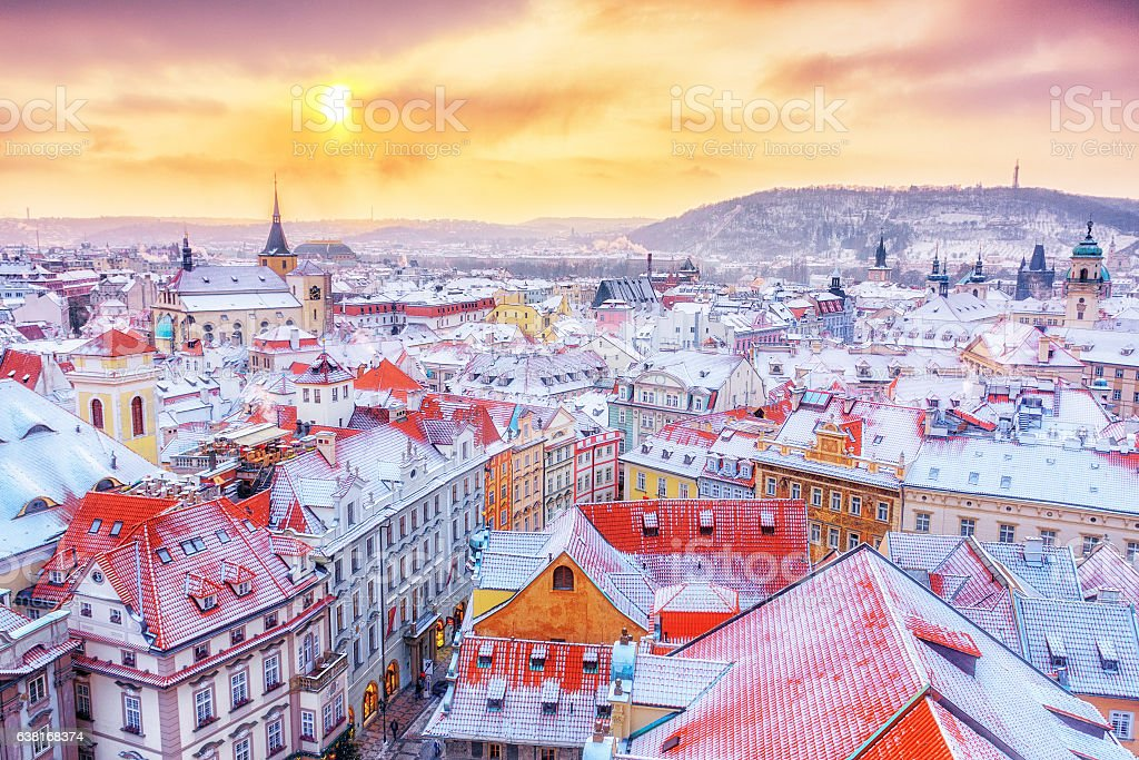 Prague, classical view of snowy roofs, city center. Winter scene. Prague down town center at winter Christmas time, classical view on snowy roofs in central part of city. Architecture Stock Photo