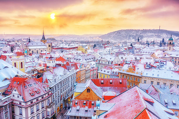 Prague, classical view of snowy roofs, city center. Winter scene. Prague down town center at winter Christmas time, classical view on snowy roofs in central part of city. prague stock pictures, royalty-free photos & images
