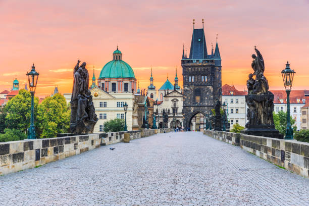 Prague, Czech Republic. Prague, Czech Republic. Charles Bridge (Karluv Most) and Old Town Tower at sunrise. prague stock pictures, royalty-free photos & images