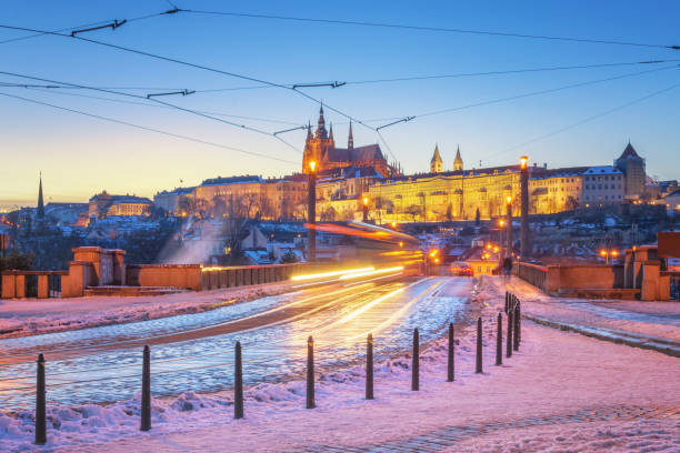 Prague in Winter, the castle and the lighttrails of a tram stock photo