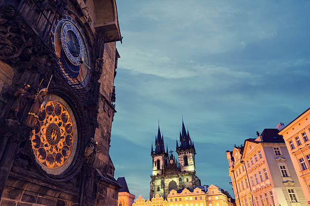 Prague Old Town Square Illuminated Old Town Square with Tyn Church and Astronomical Clock Tower in the early morning (Prague, Czech Republic). astronomical clock prague stock pictures, royalty-free photos & images