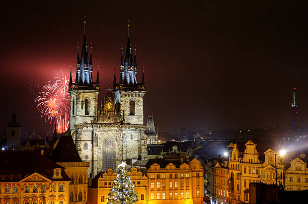 Prague old town with fireworks in the night Prague old town with fireworks behind Church of Our Lady before Tyn  in the night with old building. Capital city of Czech Republic and one of the most famous tourist place in Europe. tyn church stock pictures, royalty-free photos & images