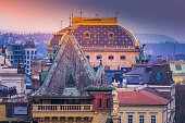 Prague panorama from above with old town and National Theatre at sunset – Czech Republic
