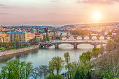 View at bridges across the river Vltava in Prague at dusk