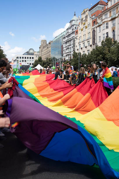 Prague Pride 2017, a big gay & lesbian pride Prague, Czech Republic, August 12, 2017: People participating in Prague Pride, a big gay & lesbian pride, unfold a giant rainbow flag at the Wenceslas square wenceslas square stock pictures, royalty-free photos & images