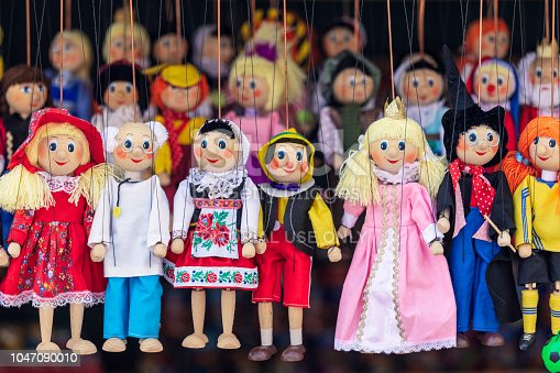 A variety of puppets for sale in a market stall in central Prague, Czech Republic.