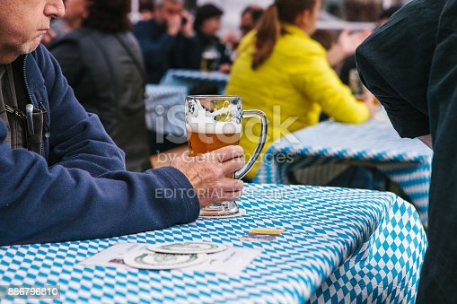 istock Prague, September 23, 2017: Celebrating the traditional German beer festival called Oktoberfest in the Czech Republic. An elderly man drinks beer with his friends. 886796810