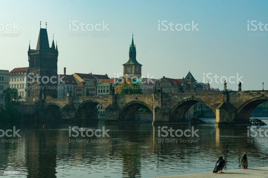 Prague, view of the Charles Bridge and the old tower by the river in the evening - Royalty-free Architecture Stock Photo