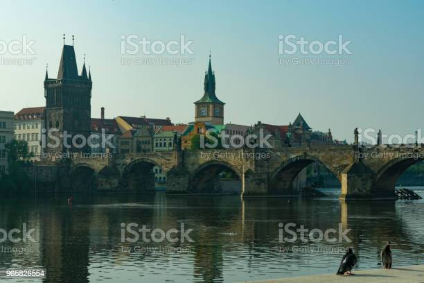 Prague View Of The Charles Bridge And The Old Tower By The River In The Evening Stock Photo - Download Image Now