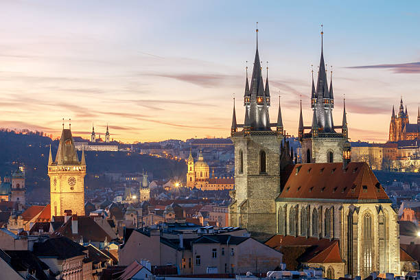 Prague. View of the city at sunset View of the Church of Our Lady before Tyn and St. Vitus Cathedral at sunset. tyn church stock pictures, royalty-free photos & images