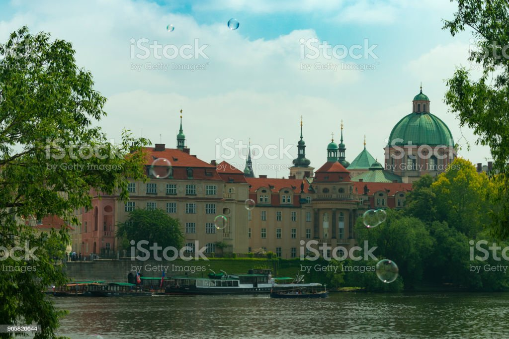 Prague, view of the old city through the river in flying soap bubbles against the backdrop of the city - Royalty-free Architecture Stock Photo