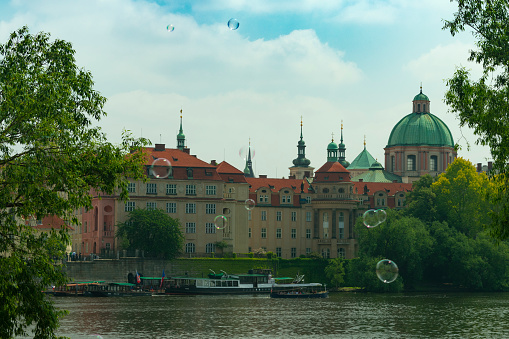 Prague View Of The Old City Through The River In Flying Soap Bubbles Against The Backdrop Of The City Stock Photo - Download Image Now