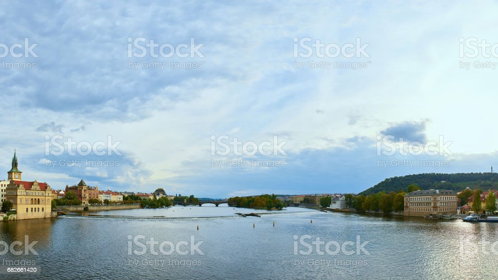 Praha panorama, The view over the Vltava river, Charles bridge and white swans from Mala Strana in Prague, Czech Republic, on a clear sunny winter day stock photo