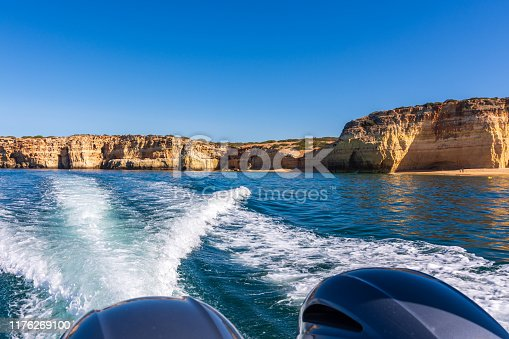 The beautiful beach is backed by high sandstone cliffs that are so associated with this section of the Algarve coast. Photographed from a boat during a sunny Summer morning.