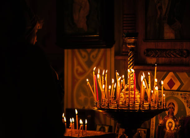 Praing woman in the orthodox church tample near the altar stock photo