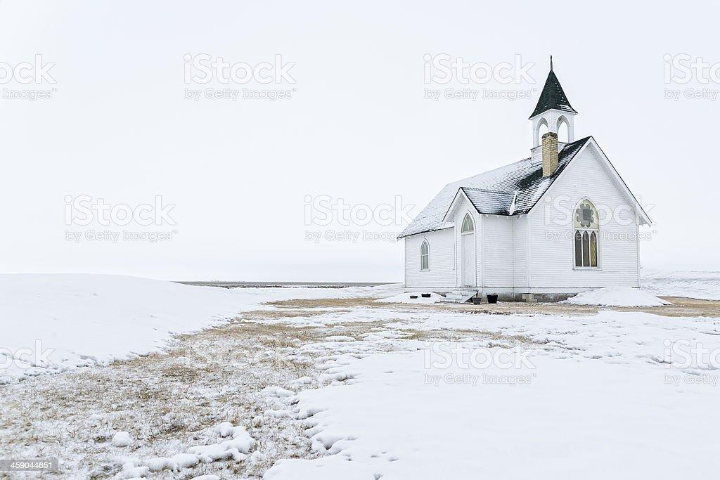 Prairie church on a foggy winter day stock photo