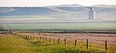 istock Prairie Grain Elevator Panorama 172410289
