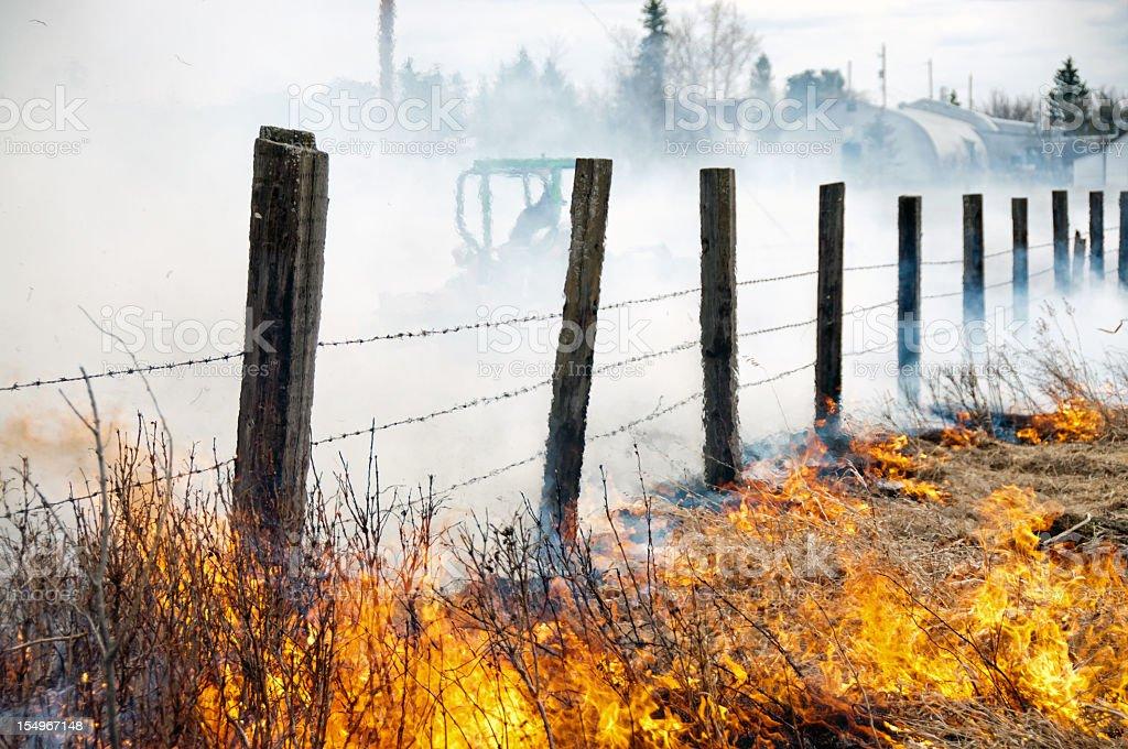 Prairie Grass Fire and Firefighter stock photo