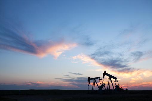 Pump Jacks working out in Weyburn Saskatchewan, Canada. Image taken from a tripod.