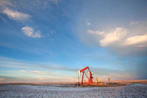 prairie pumpjack in winter - great plains stock photos and pictures