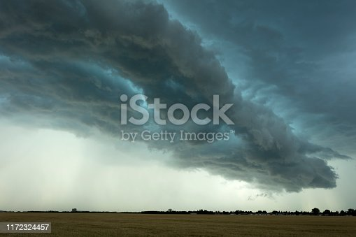 Driving along high way 363 , south of Moose Jaw. Prairie storm approaching. Image taken from a tripod.