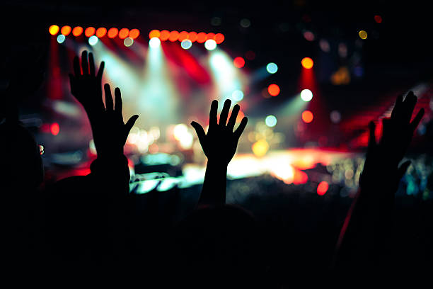 praise and worship hand up - praise and worship stock photos and pictures