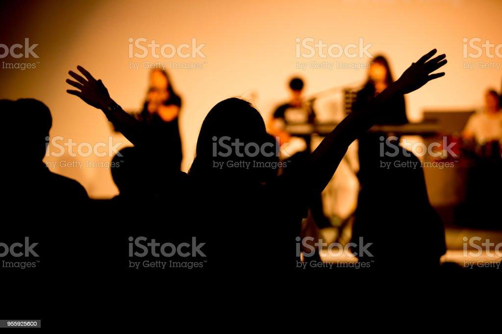 praise hand up in church stock photo