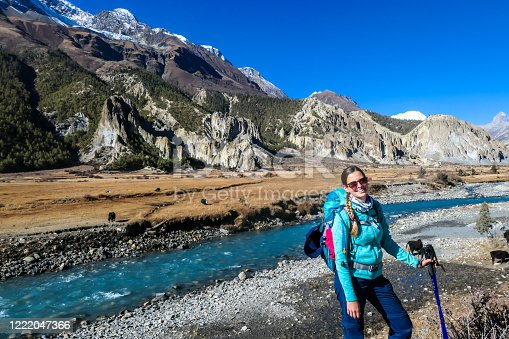 istock Praken Gompa - A woman standing by the river in Himalayan valley 1222047366