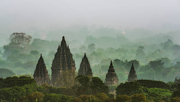 Prambanan Temple Prambanan temple viewed in foggy early morning. ancient civilization stock pictures, royalty-free photos & images