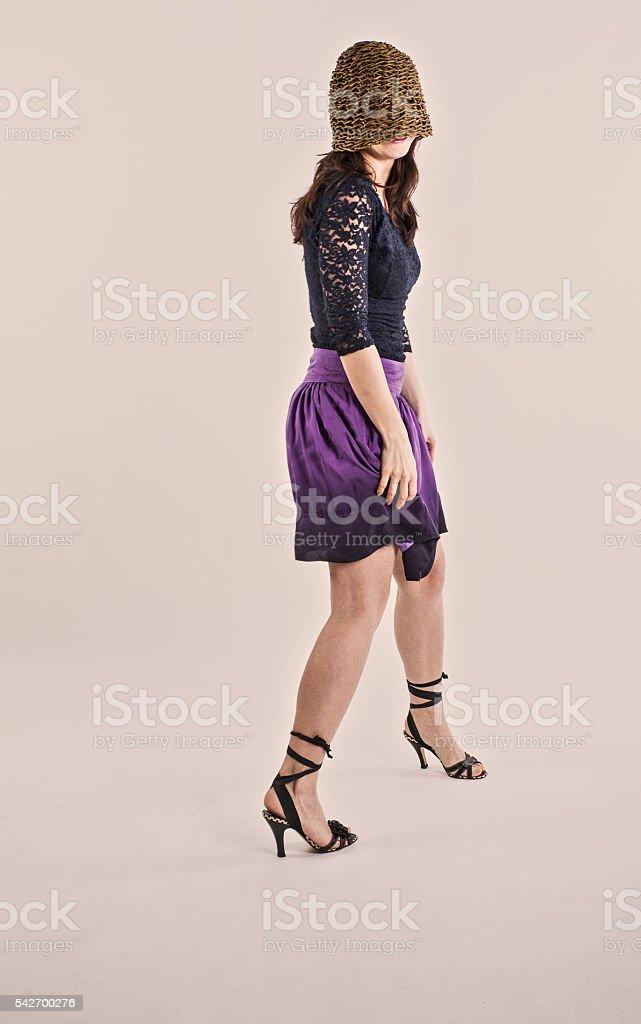 Prank. Girl jokes and dances stock photo