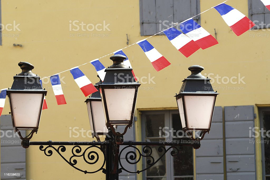 Prats-de-Mollo, 14th july, lamps and french flags stock photo