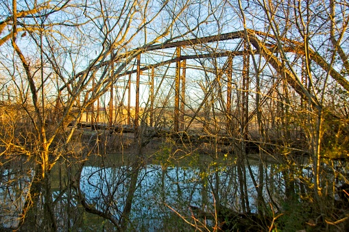 Iron beams use to build this 1919 Truss bridge in Pearl City Tennessee.
