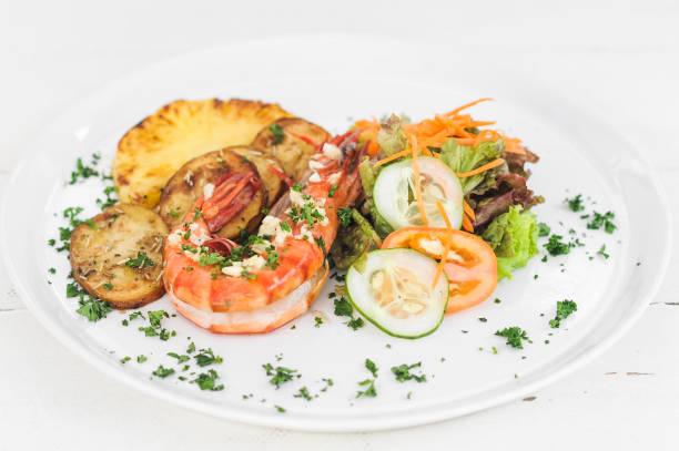 Prawn dish with potatoes stock photo