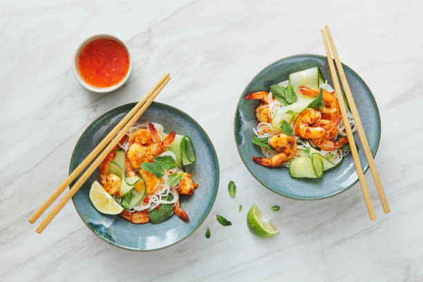 Prawn noodle salad with chilli and lime dressing Prawn noodle salad with chilli and lime dressing rice noodles stock pictures, royalty-free photos & images