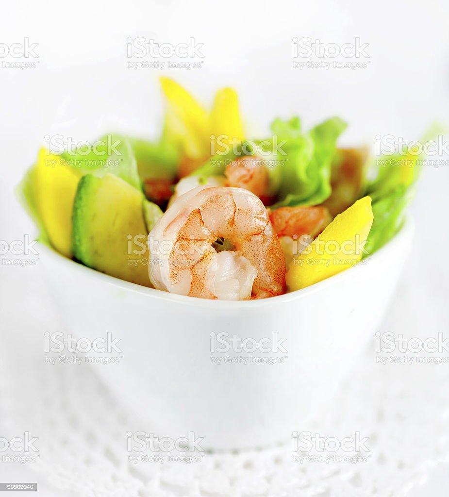 A prawn salad in white ramekin on white table cloth royalty-free stock photo