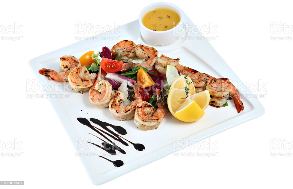 Prawns grilled with vegetable on square ceramic serving dish isolated. stock photo