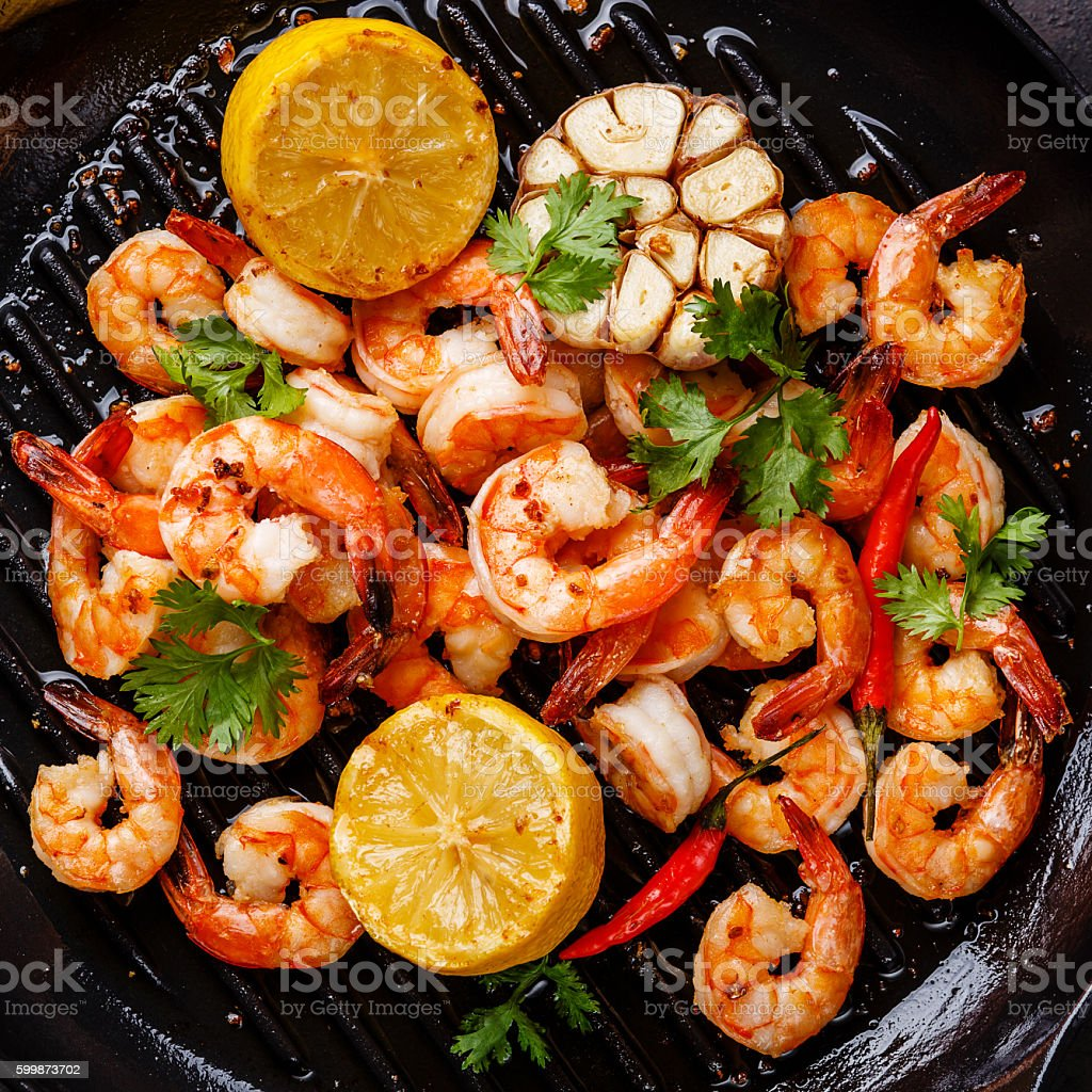 Prawns Shrimps roasted on frying pan close up stock photo