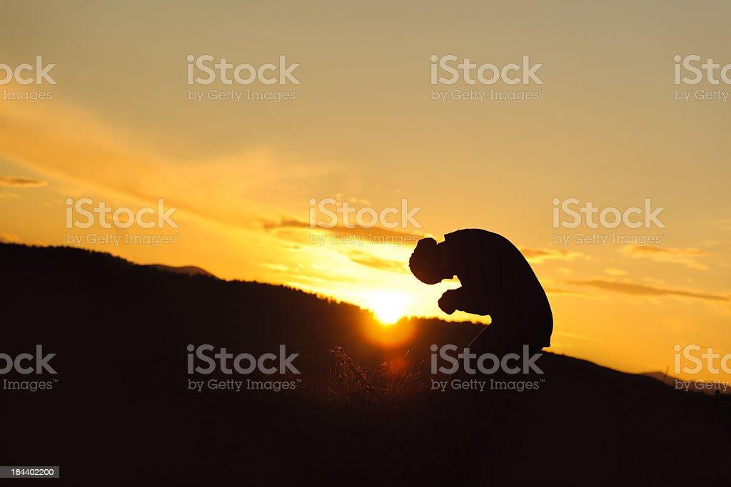 pray at sunset stock photo