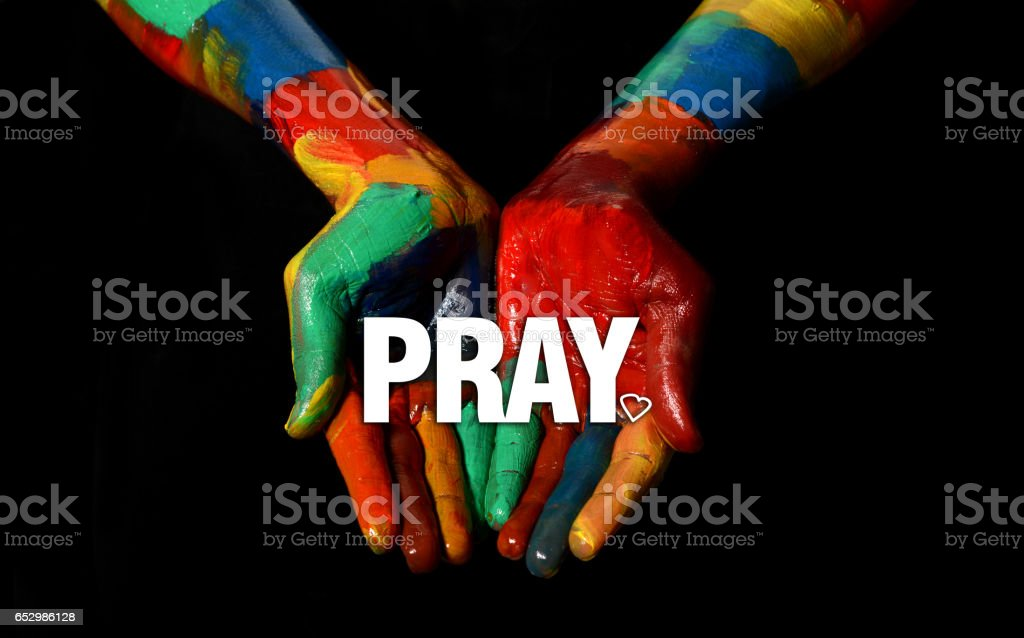 Pray concept on Multi Colors Painted hand stock photo